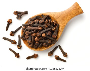 dried cloves in the wooden spoon, isolated on white background