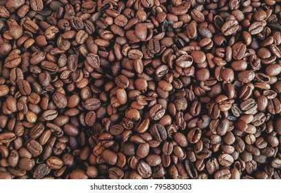 Dried coffee beans background.