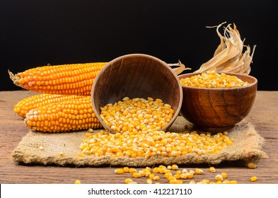 Dried corn seeds in wooden bowl on wooden board,agriculture product