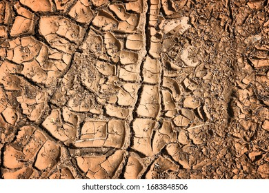 Dried cracked earth - tropical climate soil texture. Drought concept.