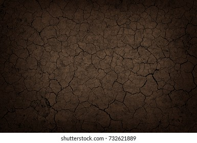 Dried and cracked ground earth texture brown and black