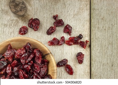 Dried cranberries in a bowl. Healthy super food. Dried cranberries on the kitchen table. Diet food.