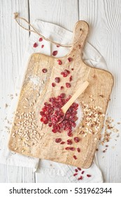 Dried cranberries  with cereal on the  white wooden table top view