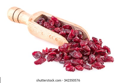dried cranberries on wooden spoon