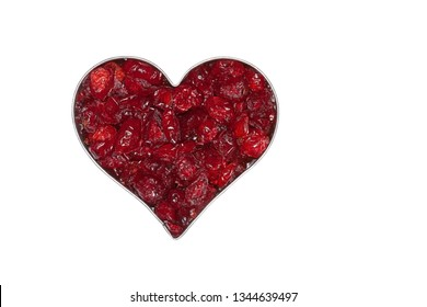 Dried cranberries surrounded by a silver heart on a white background.