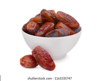 dried date fruits in the white bowl isolated on white background