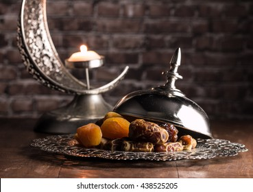 dried dates, figs and apricots with candle holder