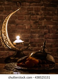 Dried dates, figs and apricots with crescent shaped candle holde