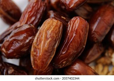 Dried dates fruit pile, closeup