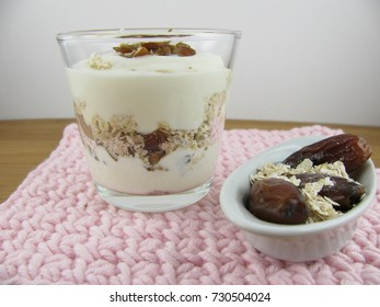 Dried dates with rolled oats and yogurt in a glass