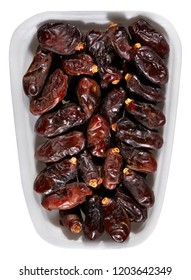 dried dates,plastic tray of dried dates isolated on white background