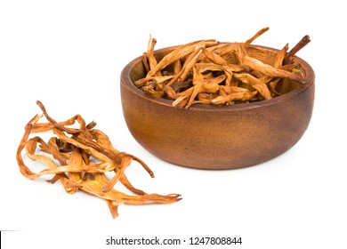 Dried daylily flower in wooden bowl isolated on white background