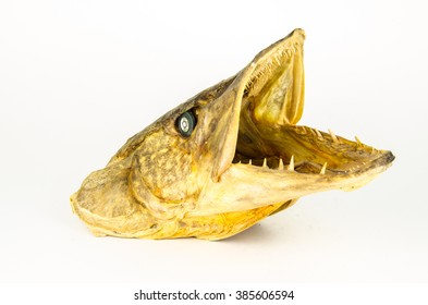 dried fish fillets on a white background isolated. Dry fish in the market.  Dried Fish. River dry salty fish. Dried fish at the Market.