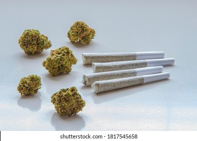 Dried flower marijuana and Pre-Rolls Cannabis Joints on a clear background