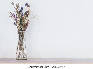 Dried flower on wooden table