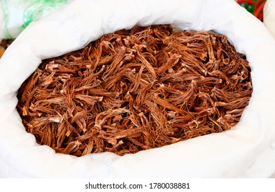 dried flower of red cotton tree in white sack saling in a local market for cooking