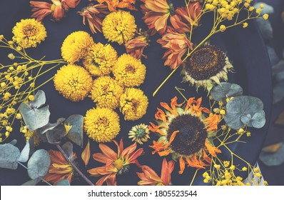 Dried flowers and autumn leaves. Autumn, fall, halloween, thanksgiving decoration.