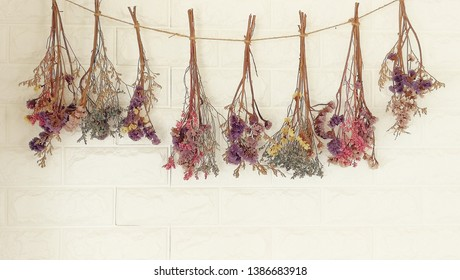 dried flowers hanging on the wall.It decoration wall of  living room