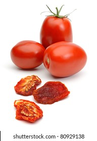 Dried and fresh plum tomatoes isolated on white background