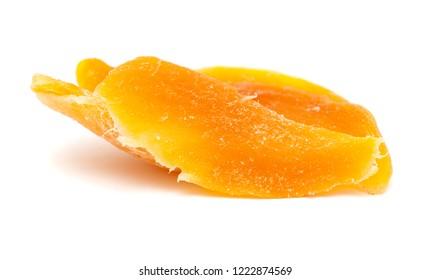 dried fruit isolated on white background - yellow mango fragments