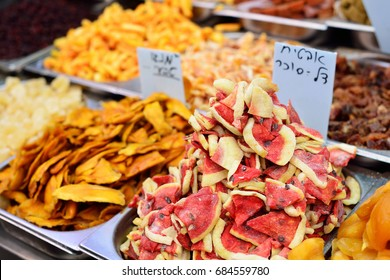 Dried fruit in the market, dried mango and watermelon. written information: watermelon