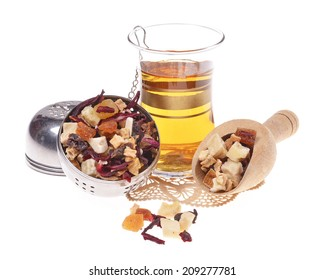dried fruit  and petals, turkish tea, with strainer  , isolated on white