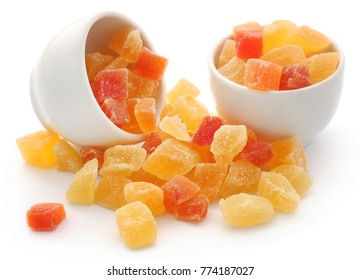 Dried fruits apricot and papaya with some others in a bowl over white
