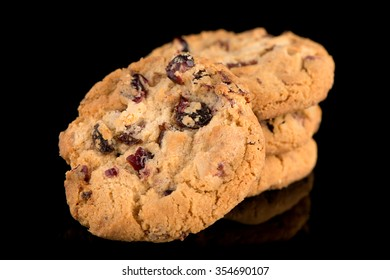 Dried fruits chip cookies isolated on black background.