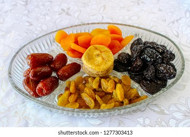 Dried fruits in a glass tray: Raisins, Prunes, Dates, Apricots, Figs. Image for the Jewish holiday Tu Bishvat, Israel