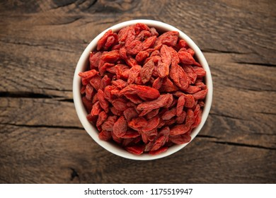 Dried fruits of Goji berries or wolfberry on rustic wooden table.