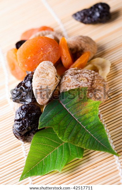 Dried fruits with green leaves