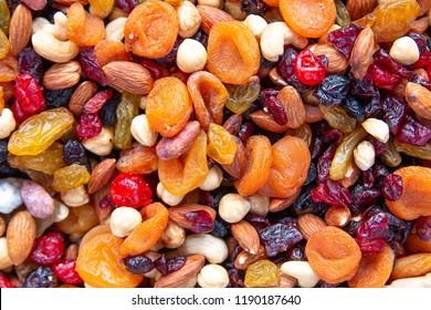 Dried fruits with nuts. Cashew, hazelnuts, peanuts, dried apricots, viburnum, raisins.