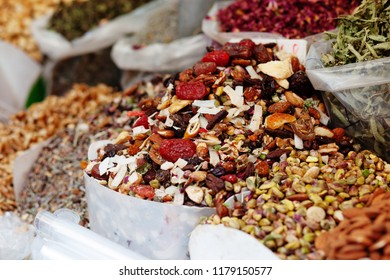 Dried fruits, nuts and herbs for tea at popular marketplace Carmel Market, Shuk HaCarmel in Tel Aviv, Israel
