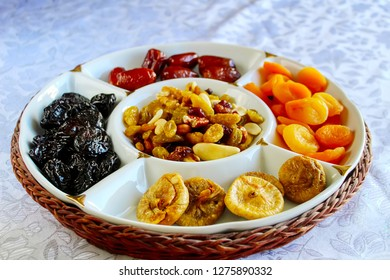 Dried fruits and Nuts on the Jewish holiday Tu Bishvat in Israel. Figs, Apricots, Prunes, Dates, Raisins, Almonds, Cranberries, Walnuts and Cashews in a glass tray