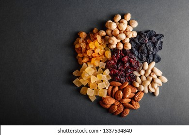 a lot of dried fruits on a black background