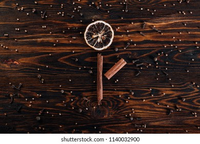 Dried fruits in the shape of a flower on wooden background