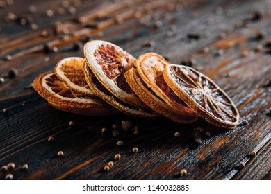Dried fruits with spices on wooden background