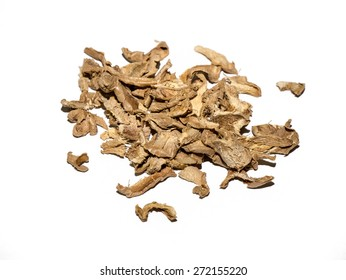Dried ginger chopped in small pieces, on white background.