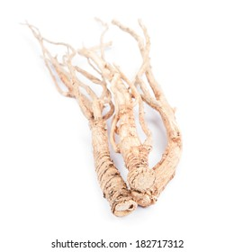 Dried ginseng on white background.