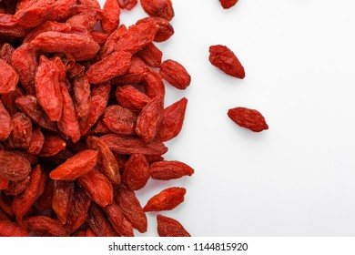 dried goji berries on a white acrylic background