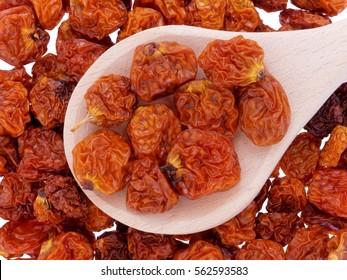 Dried golden berries (Physalis peruviana) in wooden spoon