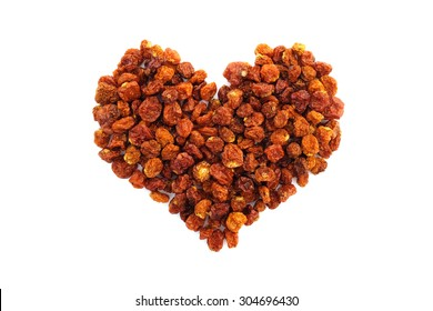 Dried goldenberries in a heart shape, isolated on a white background
