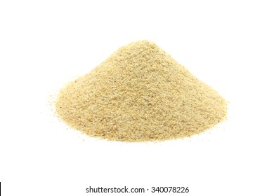 dried granulated garlic on a white background