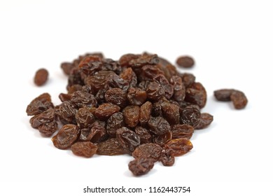 Dried grapes on a white background