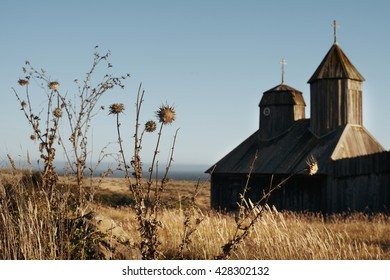 Dried grass on the background of a wooden church