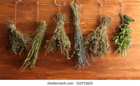dried herbs, on wooden background