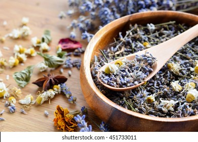dried herbs on wooden board