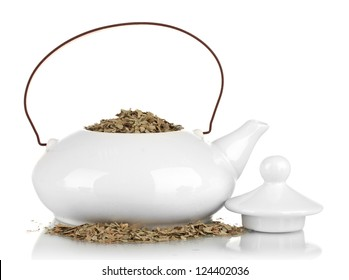 Dried herbs in teapot, isolated on white. Conceptual photo of herbal tea.