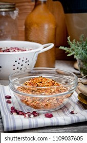Dried hot pepper mix seasoning with chile in a glass bowl on kitchen table