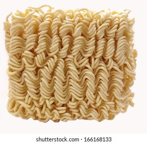 Dried instant ramen or soto noodles on white